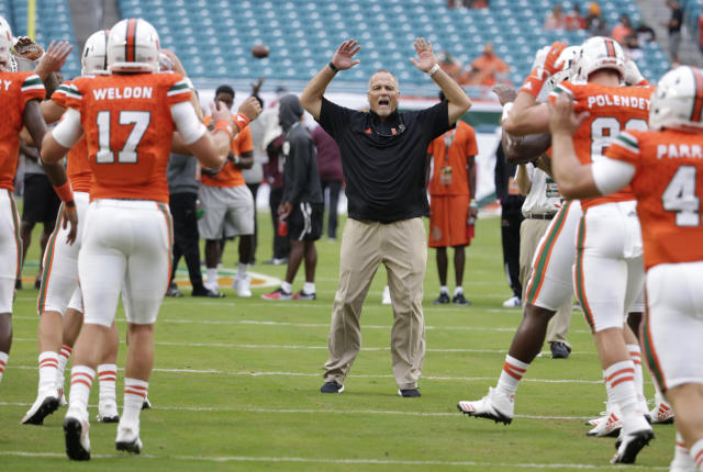 Miami head coach Mark Richt stretches with the players before an NCAA college football game against Bethune-Cookman, Saturday, Sept. 2, 2017, in Miami Gardens, Fla. (AP Photo/Lynne Sladky)