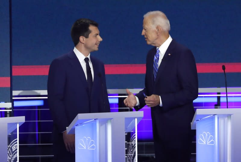 Candidates chat during the second night of the first U.S. 2020 presidential election Democratic candidates debate in Miami, Florida, U.S.