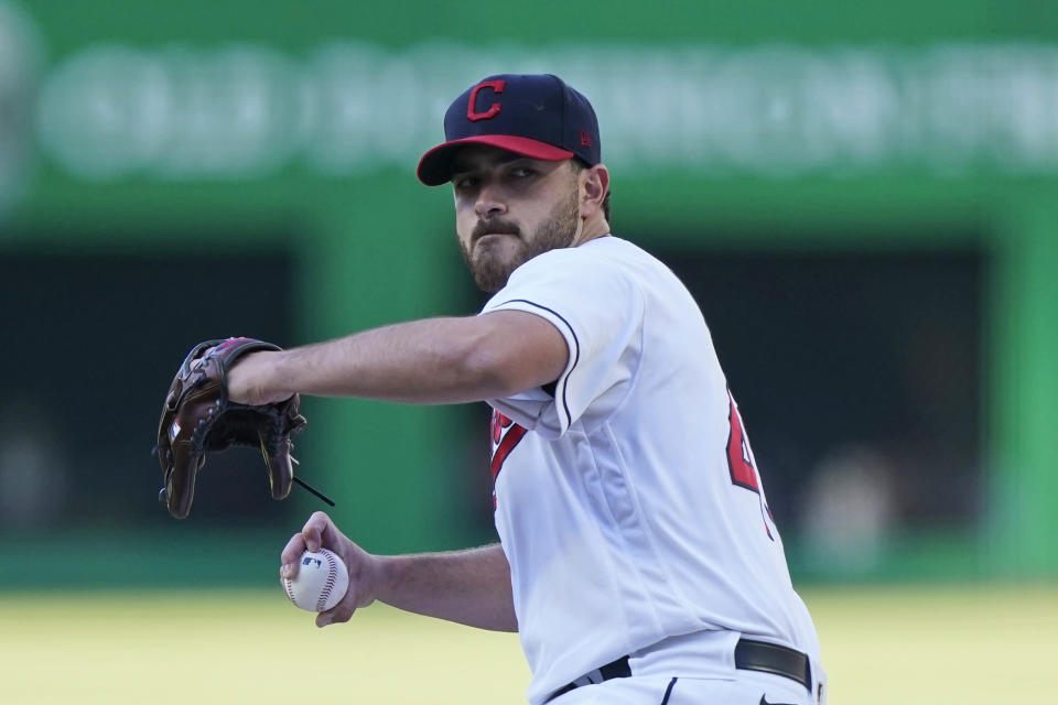 Cleveland Indians starting pitcher Aaron Civale winds up during the first inning of the team's baseball game against the Cincinnati Reds, Saturday, May 8, 2021, in Cleveland. (AP Photo/Tony Dejak)