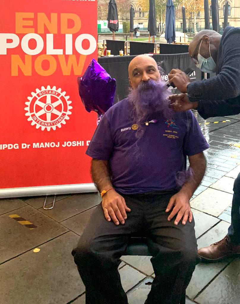 "Dr Manoj Joshi, 68, shaved his moustache for the first time in 52 YEARS at Bradford City Hall to raise funds to eradicate polio. See SWNS story SWLEmoustache; A man who shaved his moustache to raise funds for a polio vaccine says his wife can't even recognise him - after he trimmed it for the first time in 52 YEARS. Dr Manoj Joshi, 68, says he had never shaved his moustache ever since he could grow one as a fresh faced 16-year-old but decided to chop it all off in a bid to ""eradicate polio"". But after he chopped it off his shocked wife said she couldn't recognise him as she'd never seen him without it in the 42 years they had been married. The grandfather-of-two joked that it would take a lawn mower to trim his luscious facial hair - which is older than the invention of the mobile phone. Dr Joshi, a proud Rotarian, which is a worldwide charitable society with over a million members worldwide, has been involved in what he calls ""acts of giving"" for his entire life. On World Polio Day (Saturday, Oct 24) he took centre stage at a park in front of Bradford City Hall to shave off his beloved moustache in an ""emotional day""."