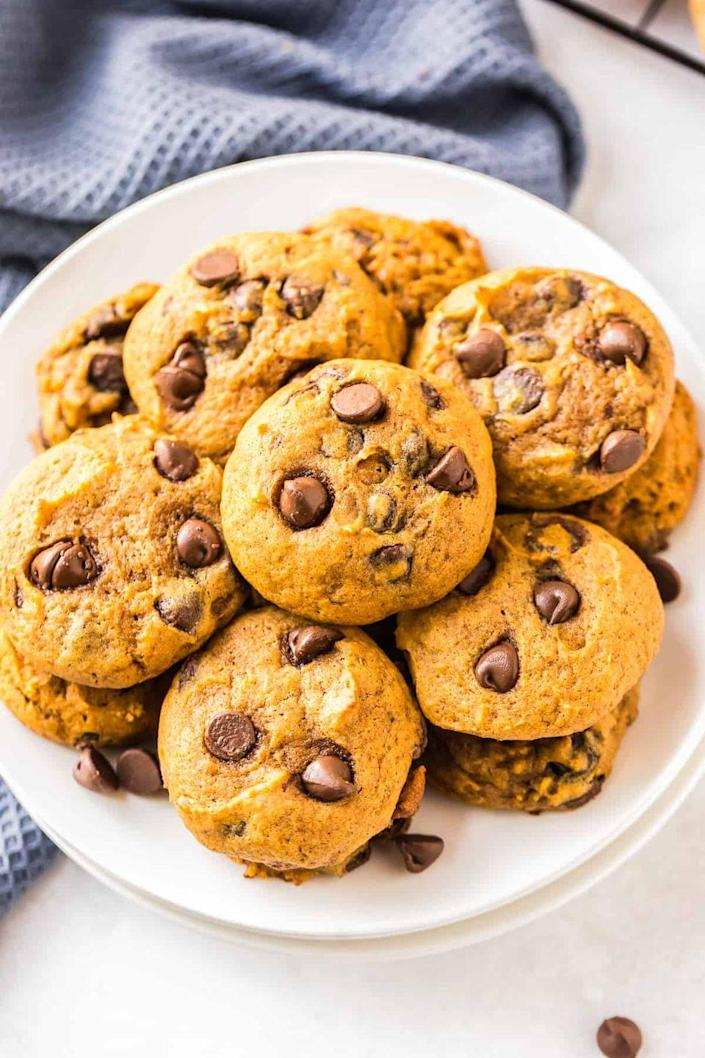 """<p>If you love a cake-like cookie, try this pumpkin chocolate chip recipe. It's packed with fall flavor and lots of chocolate.</p><p><strong>Get the recipe at <a href=""""https://www.thecookierookie.com/pumpkin-chocolate-chip-cookies/"""" rel=""""nofollow noopener"""" target=""""_blank"""" data-ylk=""""slk:The Cookie Rookie"""" class=""""link rapid-noclick-resp"""">The Cookie Rookie</a>.</strong> </p>"""