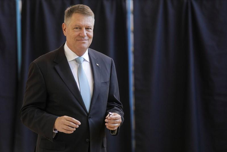Incumbent candidate Klaus Iohannis smiles after casting his ballot in the first round of a presidential election