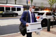 Philadelphia City Council member Bobby Henon walks to the federal courthouse in Philadelphia to face charges in his corruption trial, Tuesday, Oct. 5, 2021. (AP Photo/Matt Rourke)