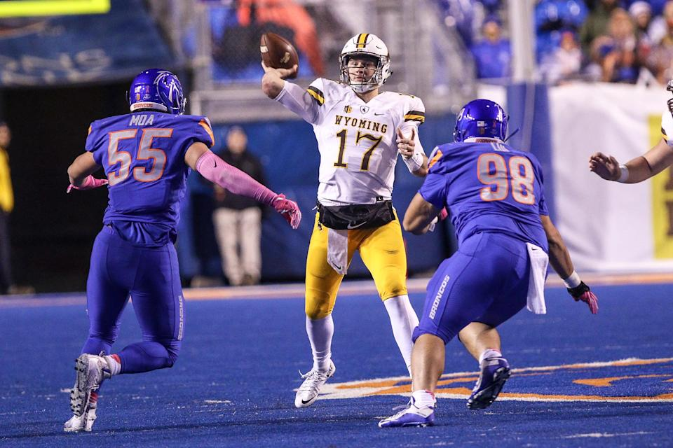 Multiple old offensive and racist tweets from Wyoming QB Josh Allen surfaced on Wednesday night, just hours ahead of the NFL draft. (Getty Images)