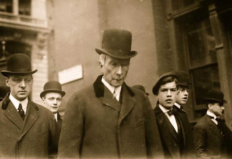 Standard Oil Company founder John Davison Rockefeller (1839 - 1937) walks on a New York city street amongst an unidentified group, 1908. (Photo by Buyenlarge/Getty Images)