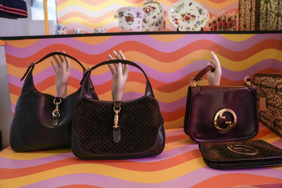 Vintage Gucci bags are displayed inside the new on-line concept store, called Gucci Vault, featuring refurbished vintage Gucci pieces and collections by young designers. The project was presented in Dazio del Ponente in Milan's Parco Sempione, where a sampling of the items on sale were displayed during the Milan Fashion Week, in Milan, Italy, Saturday, Sept. 25, 2021. (AP Photo/Luca Bruno)