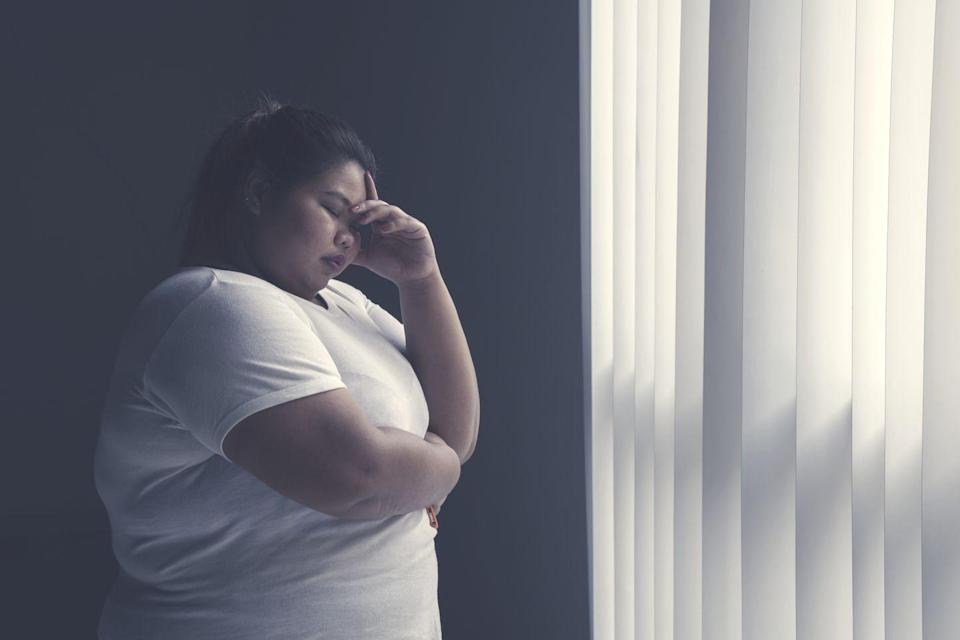 """<p>Burnout and depression can cause very similar feelings, so it's easy to confuse one for the other. """"Some experts believe depression is at the root of burnout,"""" explains <a href=""""https://secure.helloalma.com/providers/leslie-campisi/"""" rel=""""nofollow noopener"""" target=""""_blank"""" data-ylk=""""slk:Leslie Campisi"""" class=""""link rapid-noclick-resp"""">Leslie Campisi</a>, Mayo Clinic-trained wellness coach with <a href=""""https://helloalma.com/"""" rel=""""nofollow noopener"""" target=""""_blank"""" data-ylk=""""slk:Alma"""" class=""""link rapid-noclick-resp"""">Alma</a>. """"So the symptoms of burnout and depression can mirror one another."""" </p><p>That said, they technically aren't the same thing. While <a href=""""https://www.ncbi.nlm.nih.gov/pubmed/30087493"""" rel=""""nofollow noopener"""" target=""""_blank"""" data-ylk=""""slk:studies"""" class=""""link rapid-noclick-resp"""">studies</a> have found that it can be hard to discern the differences between the two, they are still classified as two different things. Burnout is more about workplace issues and you'll know you have it if you feel those three key feelings: emotional exhaustion, detachment, and lack of professional efficacy. </p>"""