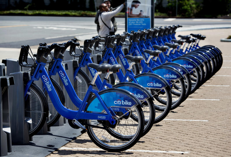 FILE - In this May 12, 2013 file photo, bicycles that are part of the NYC Bike Share program are lined up at a dock and lock station at the Brooklyn Navy Yards in New York. Chicago joins New York, Los Angeles and San Francisco when it launches its bike sharing program, named Divvy to represent its divide and share principle, on June 28. (AP Photo/Craig Ruttle, File)