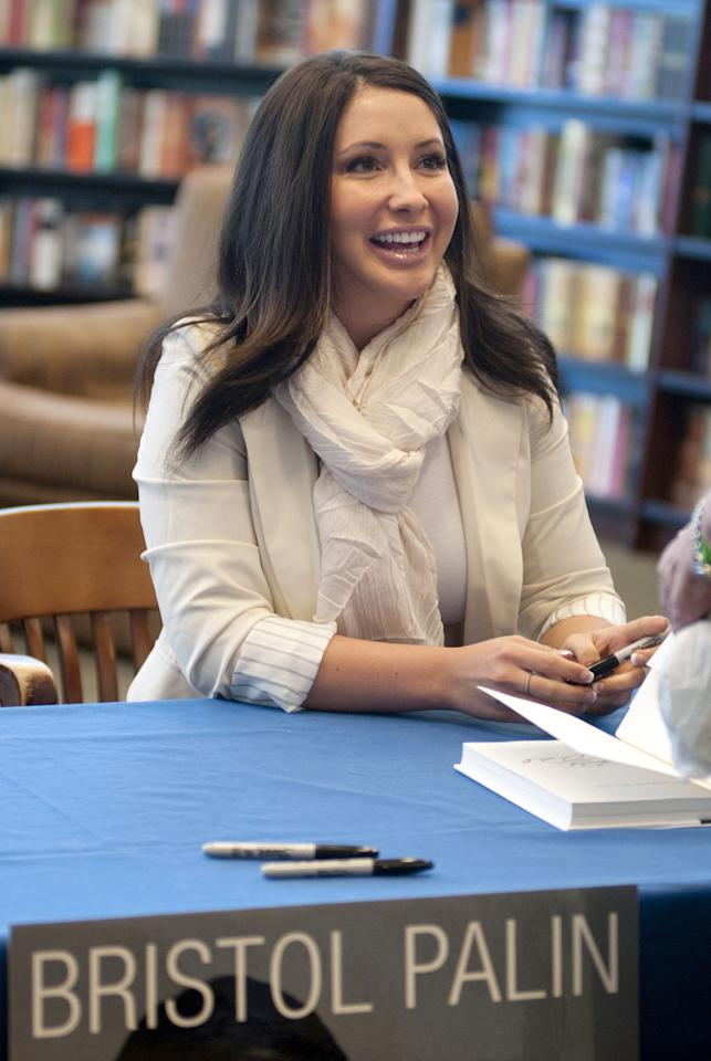 "Caption: PHOENIX, AZ - July 09: Bristol Palin signs copies of her book  ""Not Afraid Of Life: My Journey So Far"" at Barnes & Noble in Phoenix, Arizona Saturday July 9, 2011. (Photo by Laura Segall/ Getty Images)"