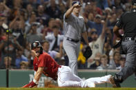 Boston Red Sox's Enrique Hernandez reacts after scoring on a sacrifice fly by Xander Bogaerts off New York Yankees starting pitcher Gerrit Cole, background, during the fifth inning of a baseball game at Fenway Park, Friday, July 23, 2021, in Boston. (AP Photo/Elise Amendola)