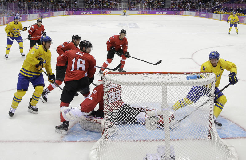 Sweden forward Daniel Alfredsson (11) scores against Switzerland in the third period of a men's ice hockey game at the 2014 Winter Olympics, Friday, Feb. 14, 2014, in Sochi, Russia. Sweden won 1-0. (AP Photo/Mark Humphrey )