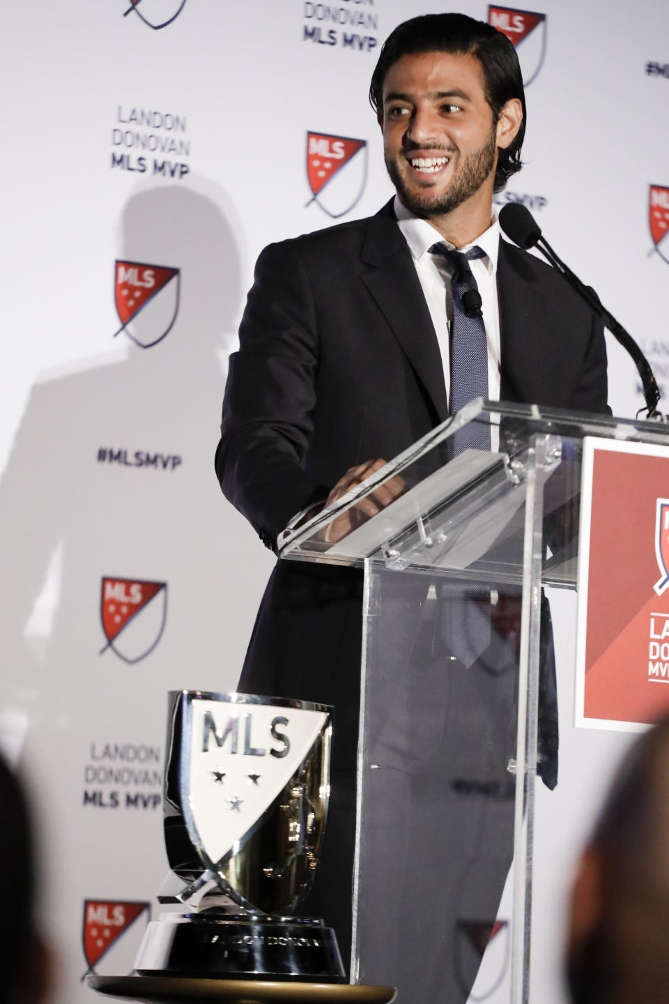 Major League Soccer's Los Angeles FC soccer player Carlos Vela smiles during a press conference after winning the Most Valuable Player award Monday, Nov. 4, 2019, in Los Angeles. Vela became the first Mexican player to win the MLS award. (AP Photo/Chris Carlson)