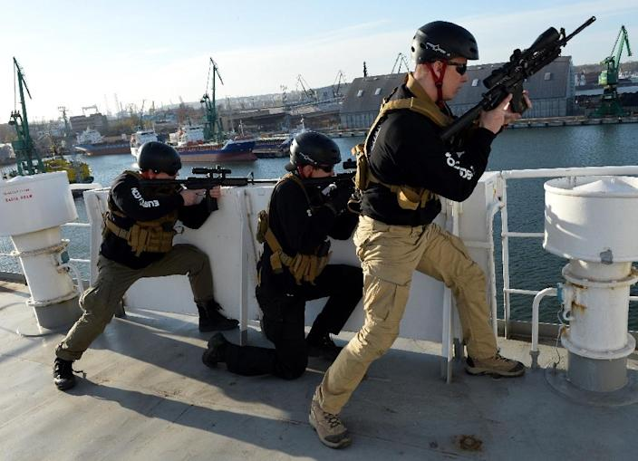 Men train to become maritime security officers on a ship docked at Poland's Baltic port of Gdynia on April 23, 2015 (AFP Photo/Janek Skarzynski)