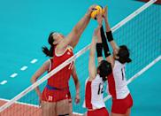 LONDON, ENGLAND - AUGUST 07: Yunli Xu #11 of China tries to get the ball past Ai Otomo #11 and Risa Shinnabe #12 of Japan during Women's Volleyball on Day 11 of the London 2012 Olympic Games at Earls Court on August 7, 2012 in London, England. (Photo by Elsa/Getty Images)