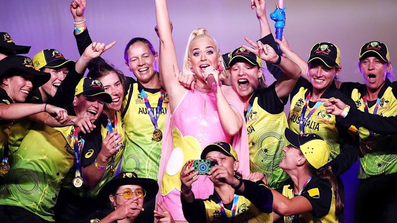The Aussie team celebrates winning the World Cup with pop star Katy Perry. Pic: Getty