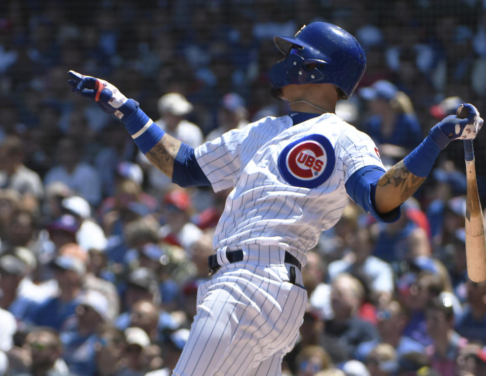 Chicago Cubs' Javier Baez (9) hits a two run home run against the St. Louis Cardinals during the first inning of a baseball game, Friday, June, 7, 2019, in Chicago. (AP Photo/David Banks)