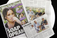 Australian newspapers report in Sydney, Tuesday, March 9, 2021, on an interview of The Duke and Duchess of Sussex by Oprah Winfrey. (AP Photo/Rick Rycroft)