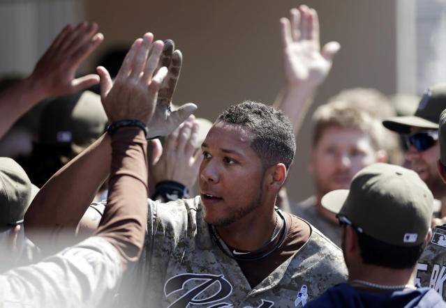 San Diego Padres' Kyle Blanks is greeted by teammates in the dugout after hitting a three-run home run during the eighth inning against the Arizona Diamondbacks in a baseball game Sunday, June 16, 2013, in San Diego. The Padres won, 4-1. (AP Photo/Gregory Bull)