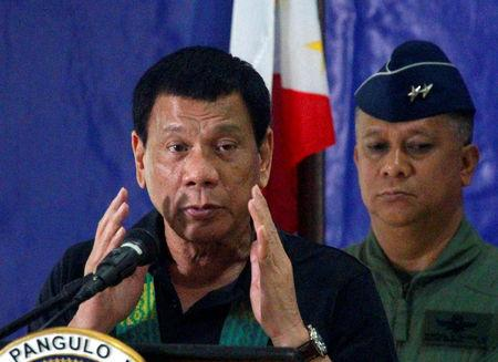 FILE PHOTO - Philippine President Rodrigo Duterte speaks before soldiers during a visit at a military camp in Awang, Maguindanao in southern Philippines