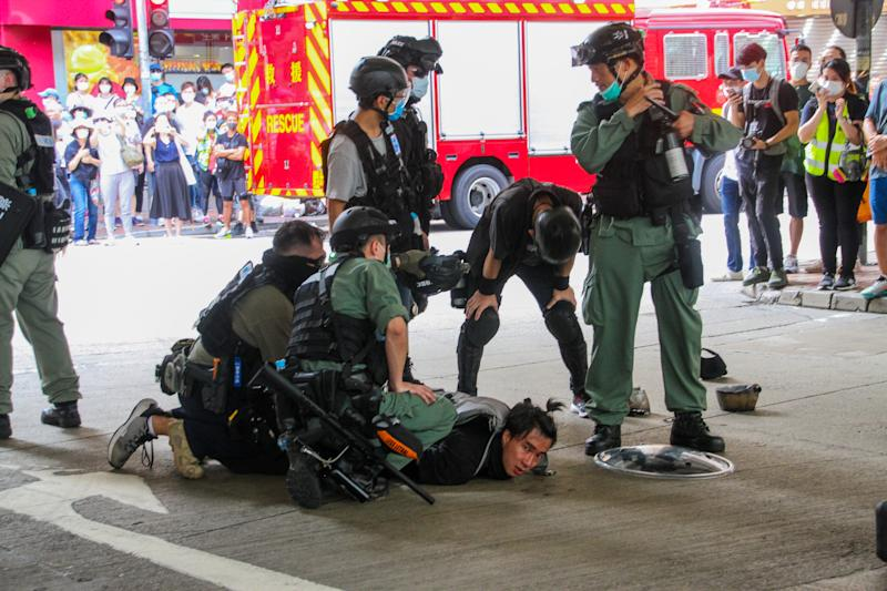 A man is arrested in Wan Chai during street protests against the new national security law in Hong Kong, 1st July 2020 (Photo by Tommy Walker/NurPhoto via Getty Images)