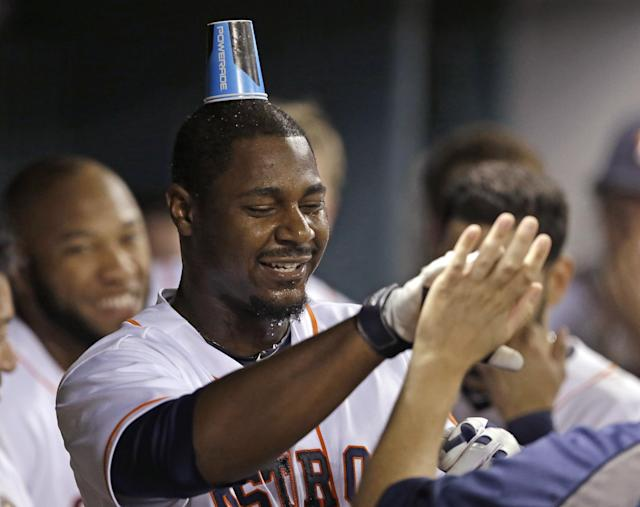 Houston Astros' Chris Carter wears a drinking cup on his head after being doused with water by teammates following his two-run home run against the Oakland Athletics in the eighth inning of a baseball game Monday, Aug. 25, 2014, in Houston. (AP Photo/Pat Sullivan)