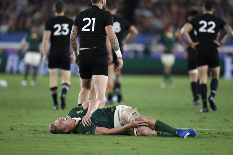South Africa's Pieter-Steph du Toit cringes in pain after being injured during the Rugby World Cup Pool B game between New Zealand and South Africa in Yokohama, Japan, Saturday, Sept. 21, 2019. (AP Photo/Shuji Kajiyama)