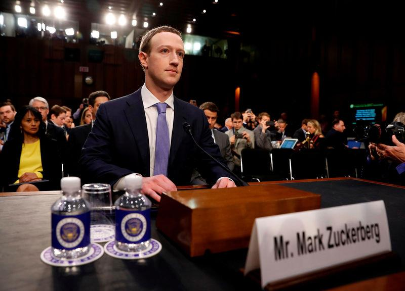 FILE PHOTO: Facebook CEO Zuckerberg arrives to testify before a U.S. Senate joint hearing on Capitol Hill in Washington