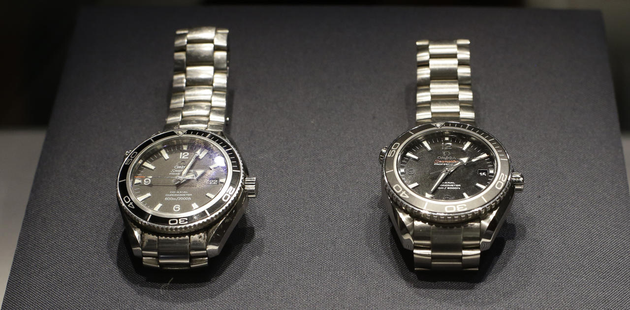 Two Omega watches, left, a Seamaster Planet Ocean model used by Daniel Craig in the James Bond movie 'Quantum of Solace', and a Seamaster Planet Ocean model which is made of Titanium and used by Craig for an action sequence in the upcoming James Bond movie 'Skyfall' is seen during the press preview of the James Bond movie memorabilia charity auction at Christie's auction house in London, Friday, Sept. 28, 2012. The watches are expected to sell for around 6-8,000 British pounds ($ 9,100-12,00 euro 6,800-9,000) each with proceeds going to UNICEF and ORBIS charities .(AP Photo/Alastair Grant)