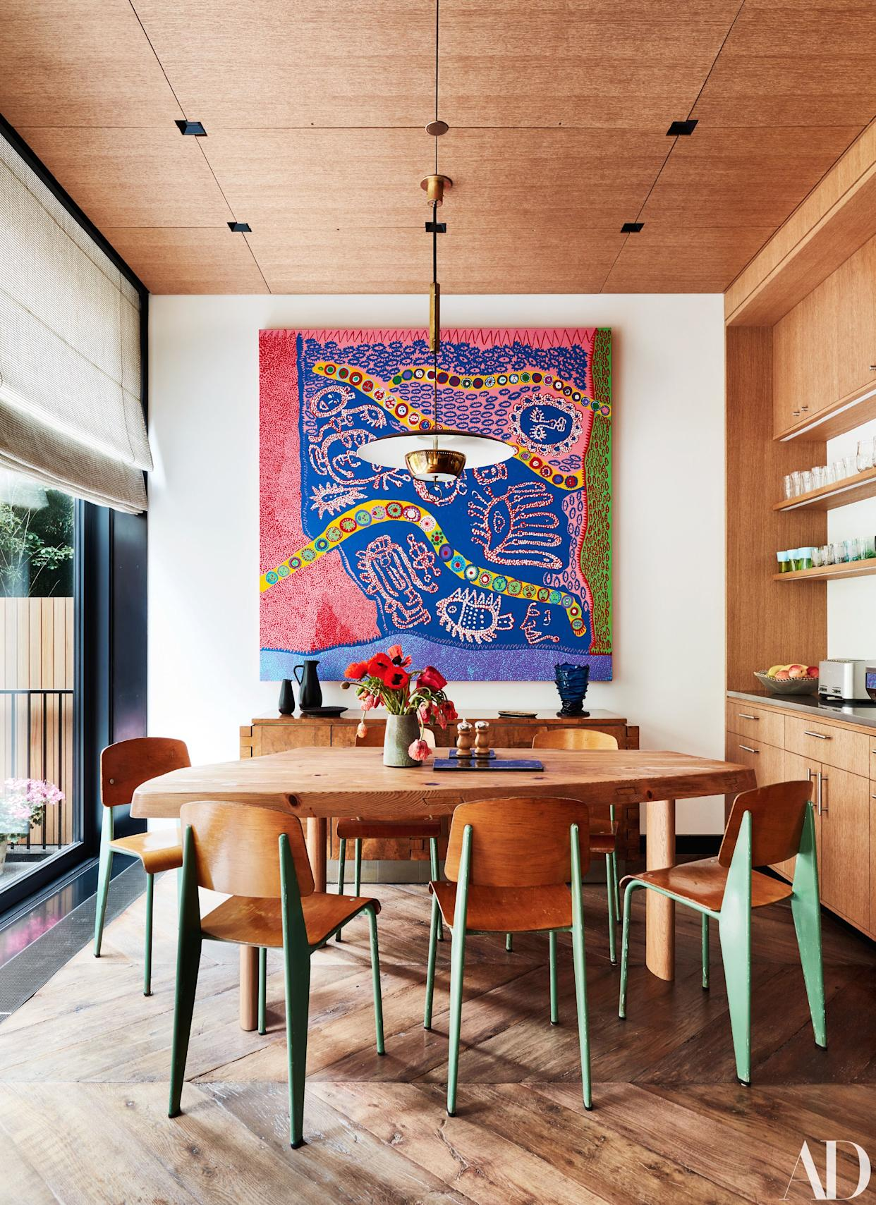 """<div class=""""caption""""> A colorful painting by Yayoi Kusama hangs in the breakfast room. </div>"""