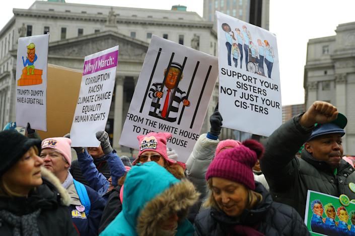 Supporters hold up signs during the Women's Unity Rally hosted by a chapter of Women's March National on Jan. 19, 2019 at Foley Square in New York City. (Photo: Gordon Donovan/Yahoo News)