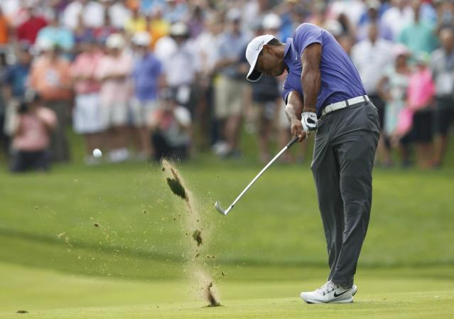 Tiger Woods of the U.S. hits his approach shot on the 12 hole during the first round of the PGA Championship at Valhalla Golf Club in Louisville, Kentucky, August 7, 2014. REUTERS/John Sommers II (UNITED STATES - Tags: SPORT GOLF)
