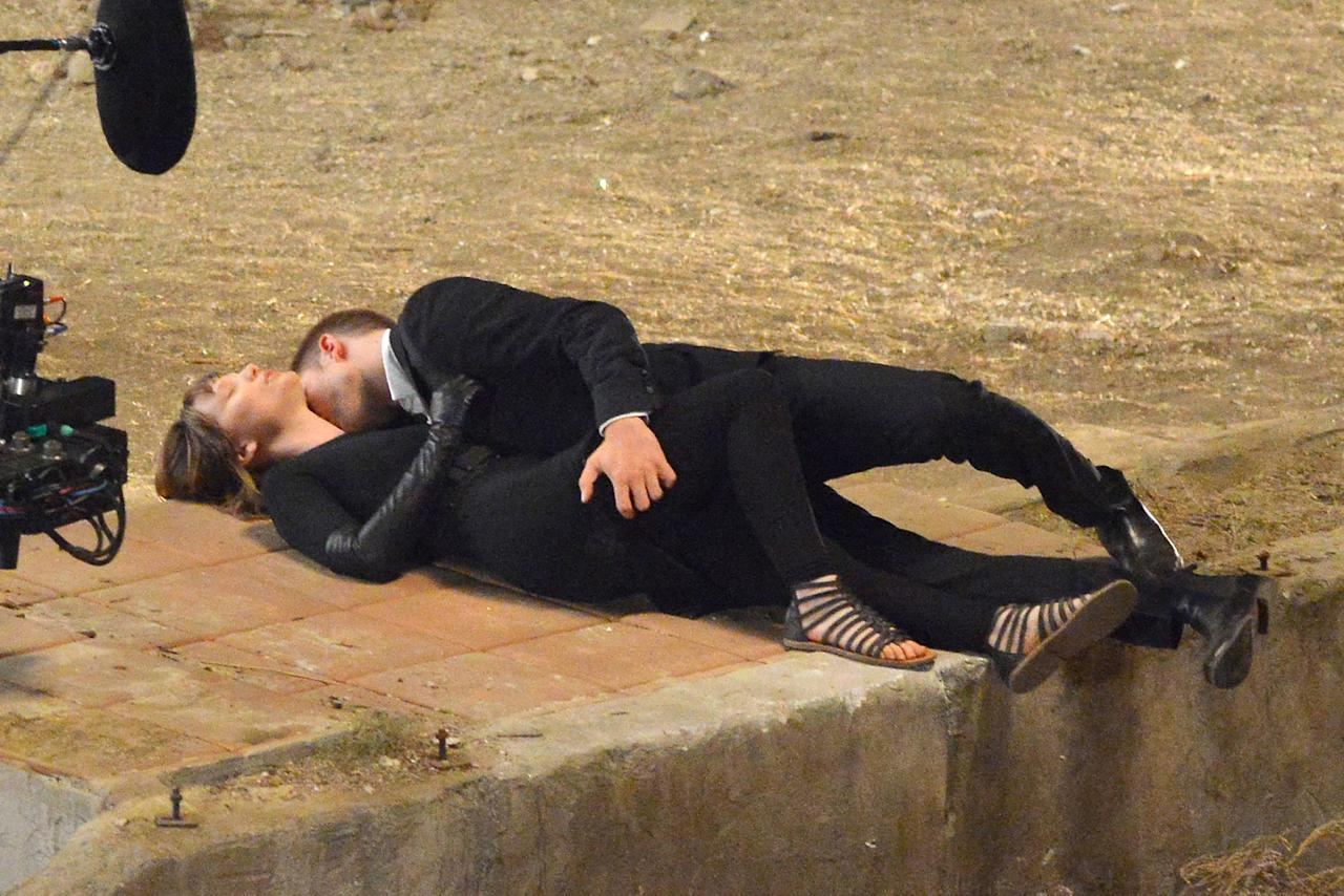 "Hollywood Hills, CA - Robert Pattinson and co-star Mia Wasikowska are seen filming a very passionate make out session on set of the David Cronenberg directed film, ""Maps to the Stars"".  Robert and Mia worked up to the final scene with four takes and filmed three different angles so lots of kissing time for the actors!  In the film Mia plays character Agatha Weiss who has recently been released from a sanatorium where she was treated for criminal pyromania and befriended a limo driver Jerome played by Robert Pattinson, who is also an aspiring actor.   The kissing scene was filmed in the make believe ruins of the house which Agatha had burnt down. 