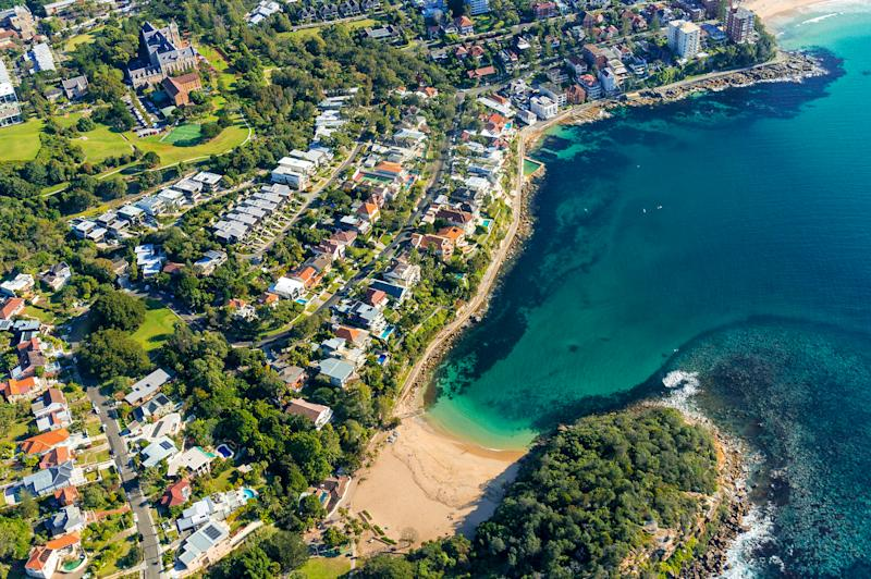 Aerial view on famous Shelly beach and Cabbage Tree bay, Manly. View on Sydney harbourside suburb from above. Aerial view on Sydney neighbourhood, Manly and Cabbage Tree Bay. Image: Getty
