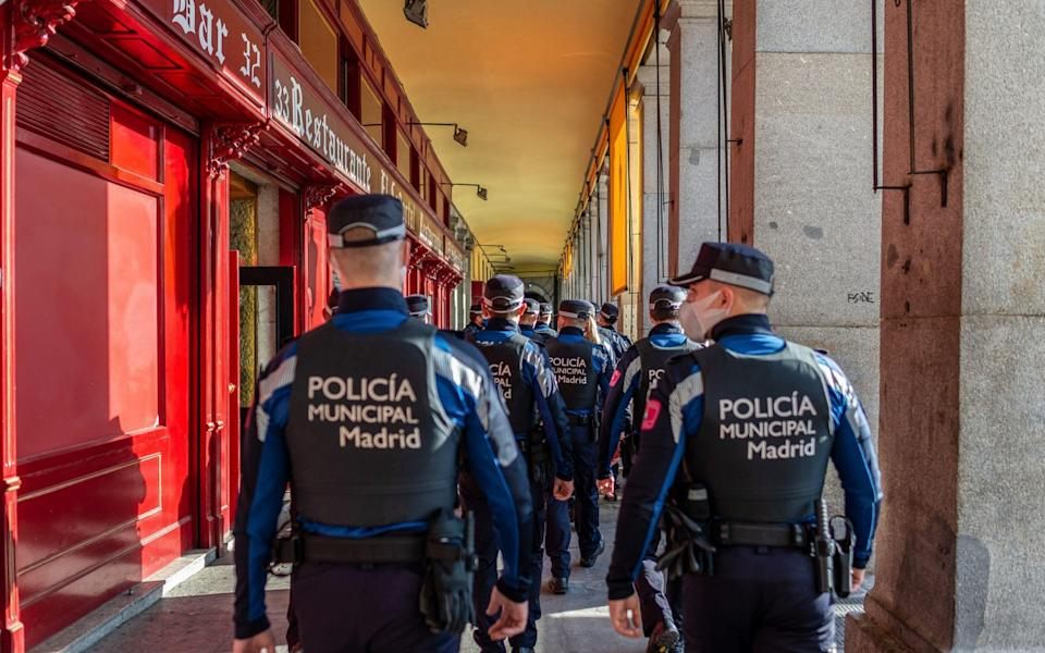 A random police check inside a restaurant at the Plaza Mayor of Madrid - ZUMA Press Inc / Alamy Live News/ZUMA Press Inc / Alamy Live News