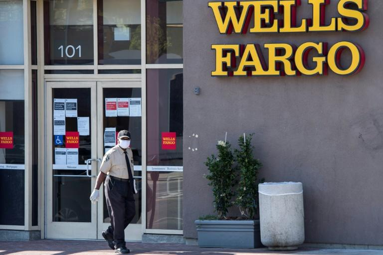 Wells Fargo reported a loss of $2.4 billion in the latest quarter and cut its dividend to shareholders (AFP Photo/VALERIE MACON)