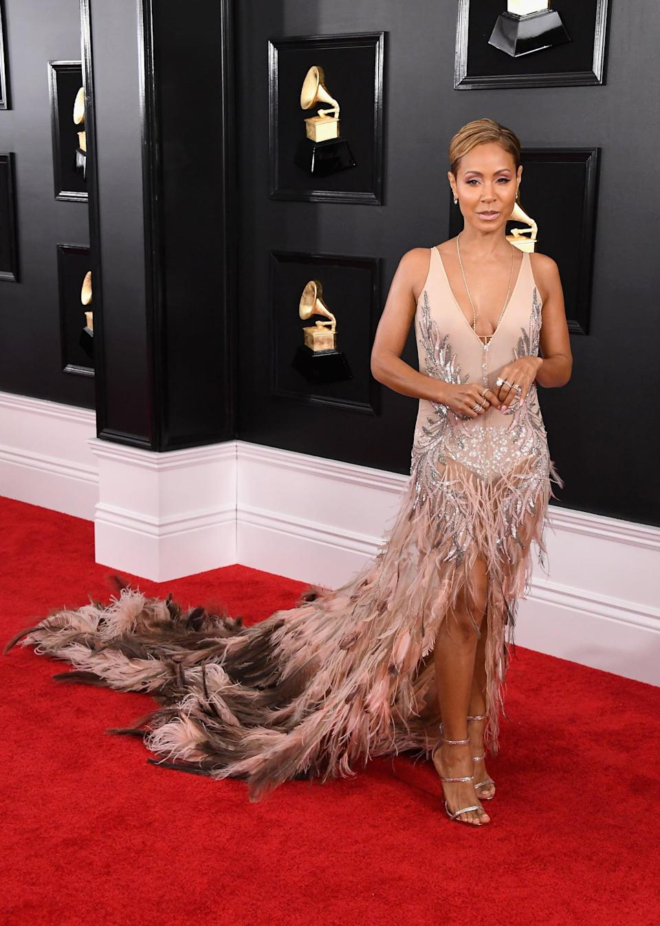 <p>Wearing a long feathered gown with Lorraine Schwartz jewels and Giuseppe Zanotti shoes.</p>