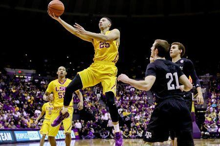 Feb 13, 2016; Baton Rouge, LA, USA; LSU Tigers forward Ben Simmons (25) shoots over Texas A&M Aggies guard Alex Caruso (21) during the first half of a game at the Pete Maravich Assembly Center. Mandatory Credit: Derick E. Hingle-USA TODAY Sports