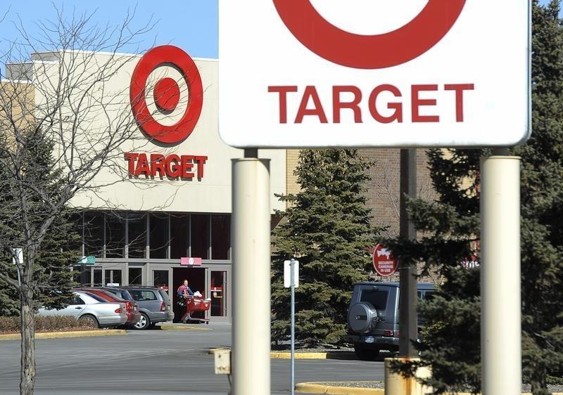A shopper leaves a Target store after Target announced that 3,100 positions would be eliminated, in St Louis Park, Minnesota
