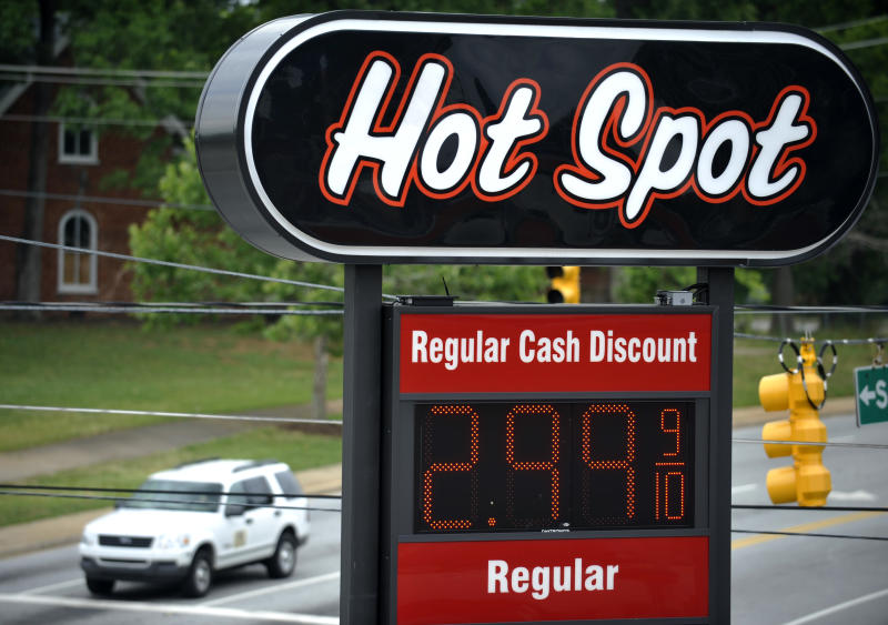A sign for $2.99 a gallon  gasoline is seen as vehicles wait for a traffic light to turn green at a Hot Spot convenience store on the corner of Henry and Converse Streets on Friday, June 1, 2012 in Spartanburg, S.C. Oil prices plunged as bleak reports on U.S. job growth and manufacturing heightened worries about a slowing global economy.  (AP Photo/Rainier Ehrhardt)