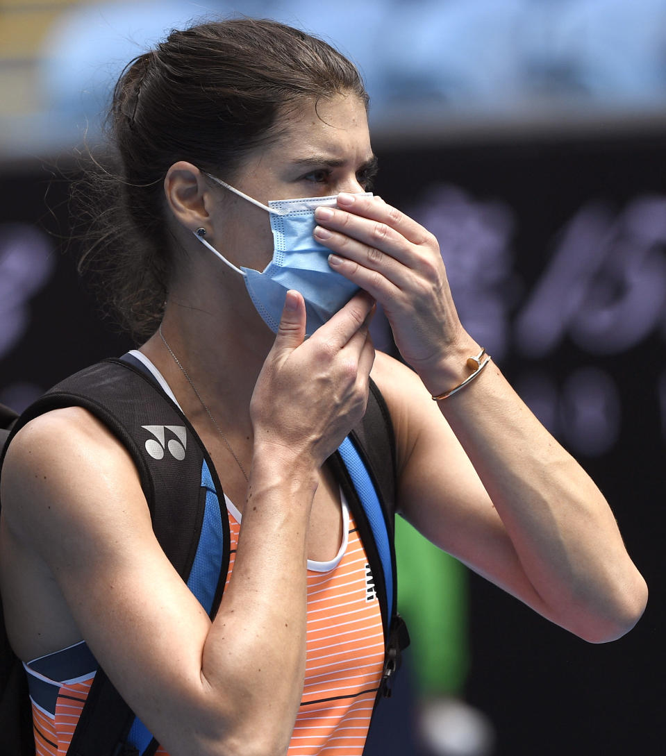 Romania's Sorana Cirstea walks from the court after he third round loss to Marketa Vondrousova of the Czech Republic at the Australian Open tennis championship in Melbourne, Australia, Friday, Feb. 12, 2021.(AP Photo/Andy Brownbill)
