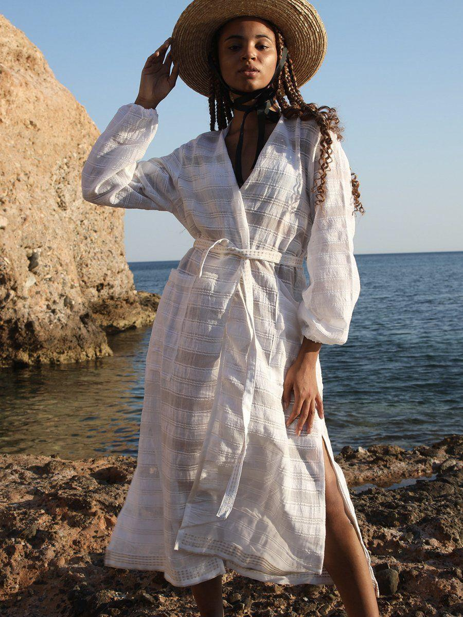 """<p><strong>lemlem</strong></p><p>lemlem.com</p><p><strong>$375.00</strong></p><p><a href=""""https://www.lemlem.com/collections/womens/products/kelali-robe?variant=13908778483754"""" rel=""""nofollow noopener"""" target=""""_blank"""" data-ylk=""""slk:SHOP IT"""" class=""""link rapid-noclick-resp"""">SHOP IT</a></p><p>Made in Ethiopia, this 100 percent cotton robe is cute enough to wear as either a beach cover-up or as an actual dress. Five percent of all purchases from lemlem will be donated to the <a href=""""https://www.lemlem.com/pages/lemlem-foundation"""" rel=""""nofollow noopener"""" target=""""_blank"""" data-ylk=""""slk:lemlem Foundation"""" class=""""link rapid-noclick-resp"""">lemlem Foundation</a>, a nonprofit organization that helps women artisans in Africa by connecting them to healthcare, education, and pathways to jobs. </p>"""