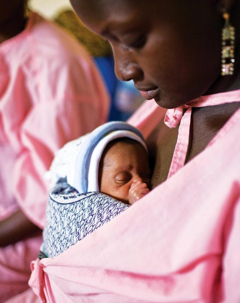 This handout photo provided by Save the Children taken on Jan. 8, 2010, shows a mother carrying her unnamed twin baby, 11 days old, in the Kangaroo Care center at the Gabrielle Traoré Hospital in Bamako, Mali. The babies were born one week premature. About 15 million premature babies are born every year _ more than 1 in 10 of the world's births and a bigger problem than previously believed, according to the first country-by-country estimates of this obstetric epidemic. The startling toll: 1.1 million of these fragile newborns die as a result, and even those who survive can suffer lifelong disabilities.    Photo by Joshua Roberts/Save the Children.