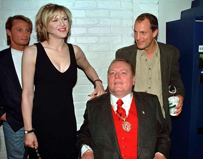 Magazine publisher Larry Flynt (in wheelchair) poses with the cast of the new film based on his life..