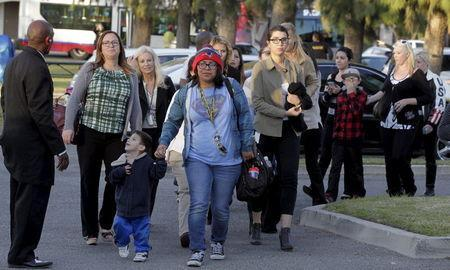 Survivors of the Inland Regional Center where gunmen shot and killed 14 people and injured another 14, are escorted off buses to meet relatives at the Rudy Hernandez Community Center in San Bernardino, December 2, 2015. REUTERS/Alex Gallardo