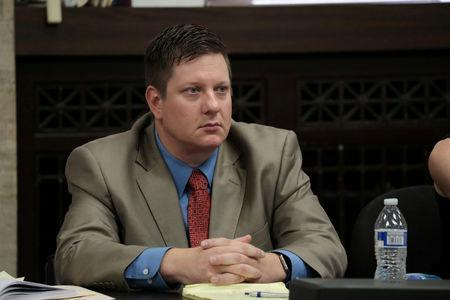 FILE PHOTO: Chicago police Officer Jason Van Dyke watches the prosecution's closing statements during his trial for the shooting death of Laquan McDonald at the Leighton Criminal Court Building in Chicago