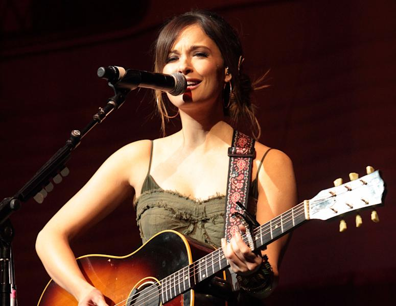 "FILE - In this March 3, 2013 file photo, country music artist Kacey Musgraves performs at the American Music Theatre in Lancaster, Pa. Musgraves and Taylor Swift top the list of final nominees for ""The 47th Annual CMA Awards"" with six nominations each. The awards show will be hosted for the sixth time by Brad Paisley and Carrie Underwood and will be broadcast live from the Bridgestone Arena in Nashville, Wednesday, Nov. 6 on the ABC. (Photo by Owen Sweeney/Invision/AP, File)"