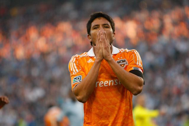 KANSAS CITY, KS - NOVEMBER 06: Danny Cruz #05 of the Houston Dynamo reacts to his shot being block by Jimmy Nielsen #1 of Sporting Kansas City in the first half during the MLS Eastern Conference Championship match at Livestrong Sporting Park on November 06, 2011 in Kansas City, Kansas. (Photo by Kyle Rivas/Getty Images)