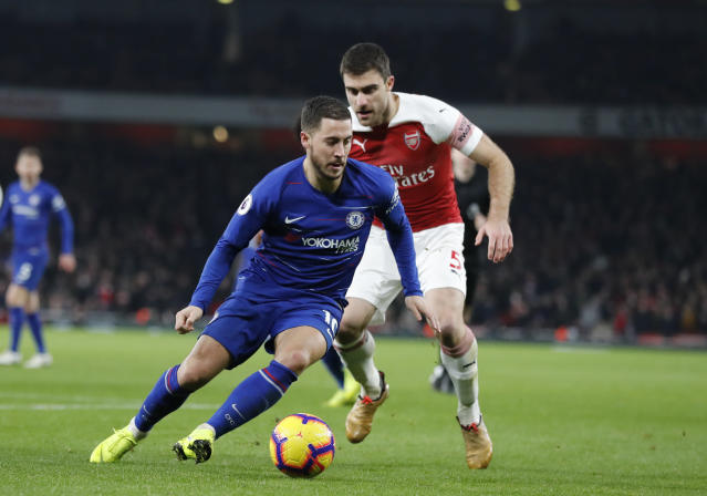 Chelsea's Eden Hazard, left vies for the ball with Arsenal's Sokratis Papastathopoulos during the English Premier League soccer match between Arsenal and Chelsea at the Emirates stadium in London, Saturday, Jan. 19, 2019. (AP Photo/Frank Augstein)