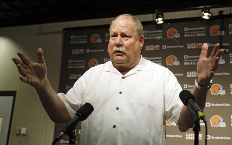 Former Cleveland Browns president Mike Holmgren gestures while answering questions during a news conference Monday, Nov. 26, 2012, in Berea, Ohio. Holmgren is leaving the team immediately rather than stay on as an adviser through the end of this season. His exit raises more questions about a possible return to coaching and what he truly accomplished during his time with Cleveland. (AP Photo/Tony Dejak)