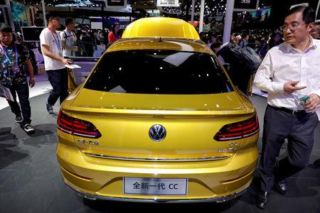 FILE PHOTO: The new Volkswagen CC is displayed during a media preview of the Auto China 2018 motor show in Beijing